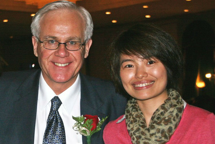 Conservative MP Bob Dechert and Xinhua News Agency reporter Shi Rong in an undated photo sent to government and media sources in 2011